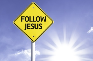 Follow Jesus road sign with sun background
