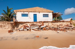 Eroded beach with house, Pititinga, Natal (Brazil)