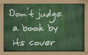 """ Don't judge a book by its cover "" written on a blackboard"