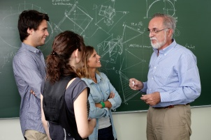 Teacher talking with students in the clasroom