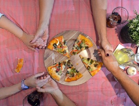 aerial view of family eating pizza at home