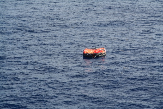 A life raft floats in mid ocean awaiting rescue